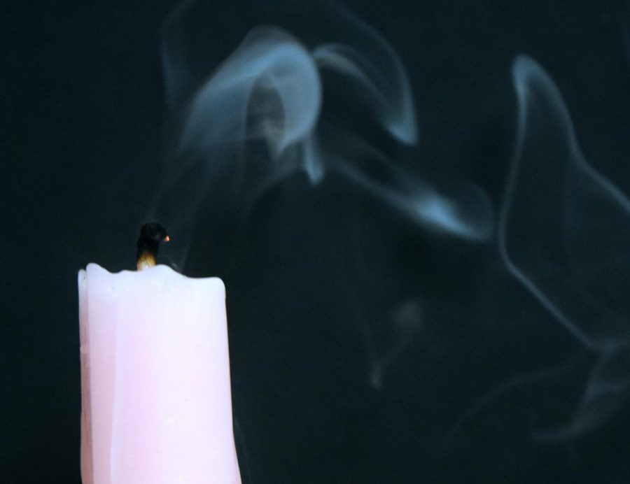 A candle smokes after having just been blown out representing a possible end to the teen suicides.