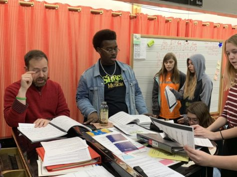 """Donkey"" played by junior Jordon Prince rehearses a song titled ""Make a Move"", about Shrek (senior James Long) being too nervous to tell Fiona (senior Miyon Roston) how he really feels. ""Donkey is such a sarcastic and fun character to play,"" Prince said. ""Not only that, his songs are not like any other character's. I think the audience will really enjoy this show."" Photo by Derek Walsh"