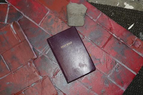 After the room had been vandalized last school year, a Bible lay in the ruins of various props and furniture. For the sake of closure, photos of the majority of the damages will not be published. Not pictured: couches slashed, holes in the walls and trash strung about. Photo by Derek Walsh