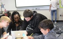 English teacher Be-Asia McKerracher assists sophomore Kaster Hughes in Honors ELA II. Photo by Daniel Smith.