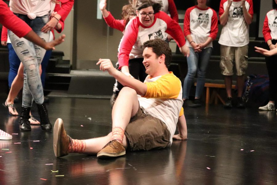 "During an improv show in fall 2019, senior James Long strikes a bizarre pose as junior Delany Breshnahan lunges towards him in a game of ""Freeze Frame."" In the game, two actors must make up a scene based on peculiar stances they must take. After some time, the host yells ""Freeze!"" prompting them to stop, mid-action, for another group to replace them and make up a whole new scene. ""The best way to get involved [in 48th St Players] is to dive right in,"" Long said. Photo by Isabel Sedwig."