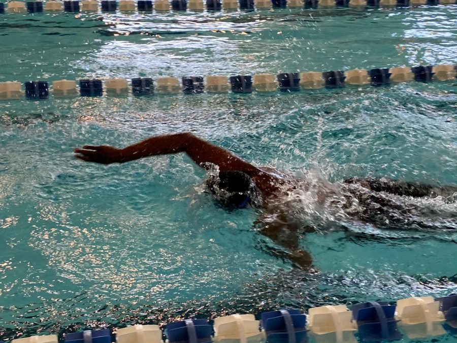 Senior Brennen Johnson Breaks School Swim Records