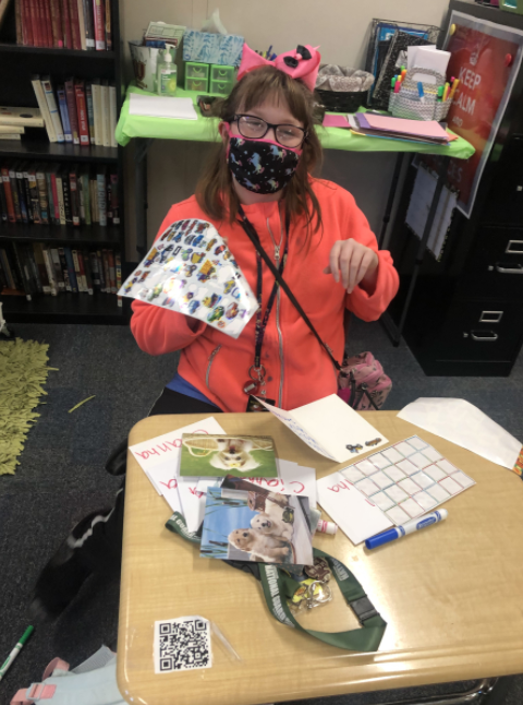 Cianna Slater happily wears her mask to stay safe in school and enjoy her socially distanced learning.